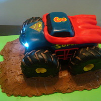"Superman Monster Truck Working Headlights  Made this for my grandson's 3rd birthday. The cake was carved, then covered in MMF, the tires are RKT covered in fondant, the ""..."