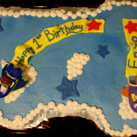 1St Birthday This is an all butter cream covered cake with fondant flags. The planes are super why toys.
