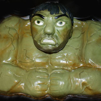The Hulk The cake is the body covered in green dyed fondant. The head is hand sculpted rice krispy treats (home made) with molding chocolate for...