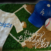 Dodger Theme Cake I made this cake for my step father's birthday. He is a HUGE Dodgers fan. I made it from a sheet cake covered in butter cream (grass...