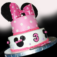 Minnie Mouse Birthday Cake This was my version of a cake my friend gave me a picture of. All cake is covered in buttercream, with fondant accents and gumpaste ears (...