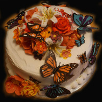 Butterfly And Flower Cake This cake is covered in butter cream. The flowers are all gumpaste. The butterflies are chocolate and done with the transfer method. Thank...