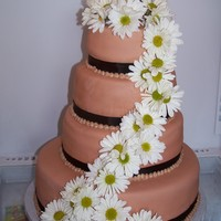 Brown Daisy Cake This cake was for a friend's wedding. I wasn't sure how a brown cake with daisy's would look, but it's what the bride...
