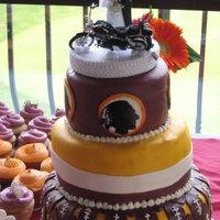 Redskins & Harley Davidson Wedding Cake   Made this for a bride and groom who share an equal love for both Harley Davidson and the Washington Redskins! First time hand painting