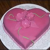 Valentine's Day Cake Fondant covered. Fondant cut out flowers.