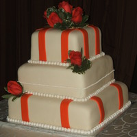 Orange And Ivory Fondant, royal icing piped pearls, fresh roses. WASC top and bottom tiers, dark chocolate center tier. Thank you for looking. :)