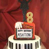 Mj Birthday Cake Fondant covered red velvet with buttercream. 50/50 gumpaste/fondant figures. MJ sillouette sprinkled with black sugar crystals, the glove...