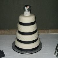 Round Quilted Round qulted fondant with pearl highlights. All chocolate cake with buttercream filling.