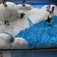 Happy Feet Birthday Cake This was my very first fondant covered cake from May 2008. I've come a long way since then. I'm glad I didn't give up on the...