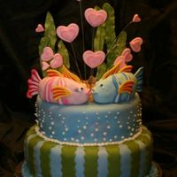 Kissing Fish I got inspired by a cake I found here on Cake Central but I used the concept as a cake topper instead of as a cake. The fish are molded out...