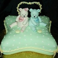 Twins Baby Shower Cake I made this cake for a lady who was having twins, a boy and a girl. For the pillow I used one of the Wilton's pillow cake pans, but I...