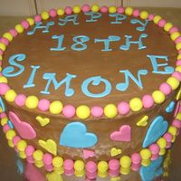 Simones 18Th Rich chocoate cake, with White chocolate Ganaech coloured brown, and fondant balls and hearts.