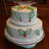 Holly Leaves And Berries Iced in buttercream with royal icing decorations. This cake was inspired by gourmetcakes.