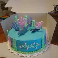 Under The Sea Buttercream with royal icing decorations and toy whale and dolphin. Inspired by BellesMom.