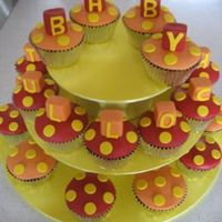 Baby Shower Cupcakes Yellow, Red and orange fondant acents on my famous secret recipe chocolate mudcake! For my friends baby shower. Hand made stand inspired by...