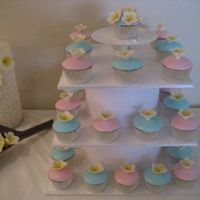 Frangipani Baby Shower Cakes Caramel mud cakes with pink and blue fondant icing with yellow frangipani. Custom built stand. For a friends baby shower with a summer...