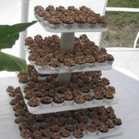 232 Mini Chocolate Mudcake 232 mini chocolate cupcakes with buttercream icing and silver balls. For a friends wedding