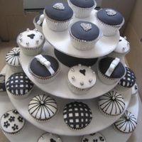B&w Weding Cupcakes Black and white cupcakes I did for a friends wedding. Made the stand as well and covered with icing