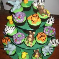 Jungle Animals Jungle Animal cupcakes for a kids party. The lady thought they were just going to be a stickers on the top of the cakes so was surprised...