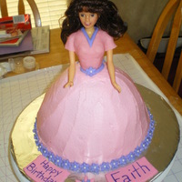 Doll Cake Buttercream icing, fondant decorations, bodice is fondant. First time making a doll cake.