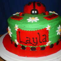 Lady Bug buttercream frosting, Lady bug -marshmallow treat covered with fondant, fondant decorations.
