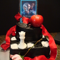 Twilight New Moon I incorporated the book covers of all 4 books in my cake. The apple for Twilight, the flower for New Moon, the frayed red ribbon for...