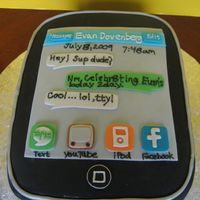 Itouch Cake This was made for a boy's 14th birthdat. Yellow cake covered in black fondant. Icons were cut out of colored fondant.