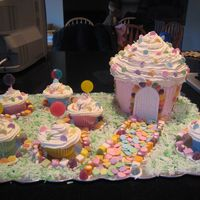 Candyland Cake  Wilton giant cupcake pan iced in buttercream, using doors/windows from castle set. Cupcakes bakes in silicon cups with giant confetti and...