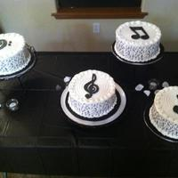 Music Note Cakes   Cakes done for piano recital. I did an edible image of music notes to wrap around the cakes and topped with a gumpaste music note.