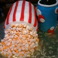 "Ready For A Movie  This cake is all edible except the straw!! ""Popcorn Carton"" is 3-6"" round cakes, torted, dirty iced, and covered with..."
