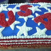 Memorial Day Cake  This is a quarter sheet cake iced in buttercream. The stars were stamped onto the cake then the letters we stamped using cookie cutters....