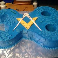 "Mason Brick Number Cake  My client asked for a carved number cake for her husband's 38th birthday. He is also a mason. Numbers carved from 4-6""round cakes..."