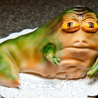 Jabba The Hutt Cake Jabba was covered in fondant and then sprayed with an airbrush.