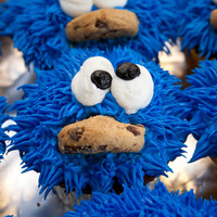 Cookie Monster Cupcake He was decorated with bc and then I stuck a mini chocolate chip cookie in his mouth.