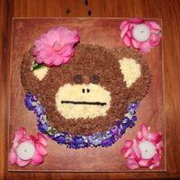 Hawaiian Monkey Monkey cake for our daughters birthday. It is a vanilla cake with chocolate buttercream. The flowers and petals are live flowers from our...