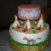 Native American Theme The drum is made of Fondant. Hoovering over a teepee village. This was for a multi national graduation party. Teepee's and horses were...