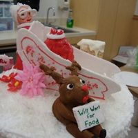 Mrs Claus And Reindeer Mrs Claus is polishing up the sleigh while rudloph seeks work!