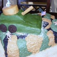 Camoflauge Army Birthday Cake I did this cake for a friend. It was her son's 7th birthday. The camo pattern was all freehand in buttercream. The tank was carved out...