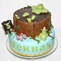 Shrek In His Mud Bath.. For my sons 5th birthday I made this Shrek cake. He loved the Shrek baby and the donkey dragons in the movie Shrek 3, so he wished these on...
