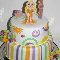 Bratz.. My 8 year old daughters wish was a Bratz doll (Chloe) on top of her cake...So I tried my best and this is the result...The whole cake,...