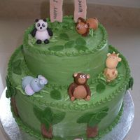 Jungle/zoo Animal Birthday Cake   2-tier chocolate cake covered in buttercream with fondant animals, leaves and trees.