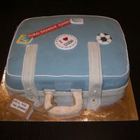 Goodbye Cake Half chocolate, half vanilla cake with raspberry flavoured buttercream filling. Suitcase and stickers decorated in fondant.