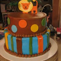 Safari Baby Shower Cake Safari baby shower cake. It matched the invitation. Fondant accents, cake decorated in chocolate buttercream and buttercream on bottom. The...