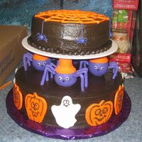 Halloween Spiders This is a different version of the Halloween cake in the Wilton Yearbook 2009. We left the pumpkin off and put the spider web. This is bc...