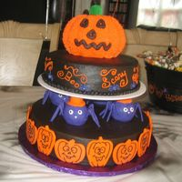 Halloween With Pumpkin On Top This is the cake from the Wilton Yearbook 2009. We used bc icing and fondant decorations.