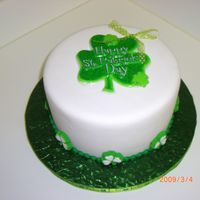 "Lucky 8"" round covered with fondant with green fondant ball border. Used a plastic clover decoration for top and made a bow for top. Used..."