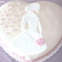 Bride Cameo Cake Covered in fondant. With a colorflow cameo.