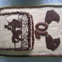 Fishing Made for my Dad's 70th b-day. Black Joe cake w/ PB icing & chocolate transfer of my dad sitting in his boat fishing.