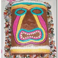 Luau Totem Cake  Made for my daughter's Hawaiian Luau birthday party. I formed the nose w/ fondant & covered with chocolate buttercream.Wood grain...