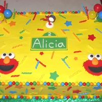 "Elmo Cake 2 2"" thick 12""x18"" chocolate cakes with lemon cream cheese filling iced with pastry pride and decorated with fondant stars,..."